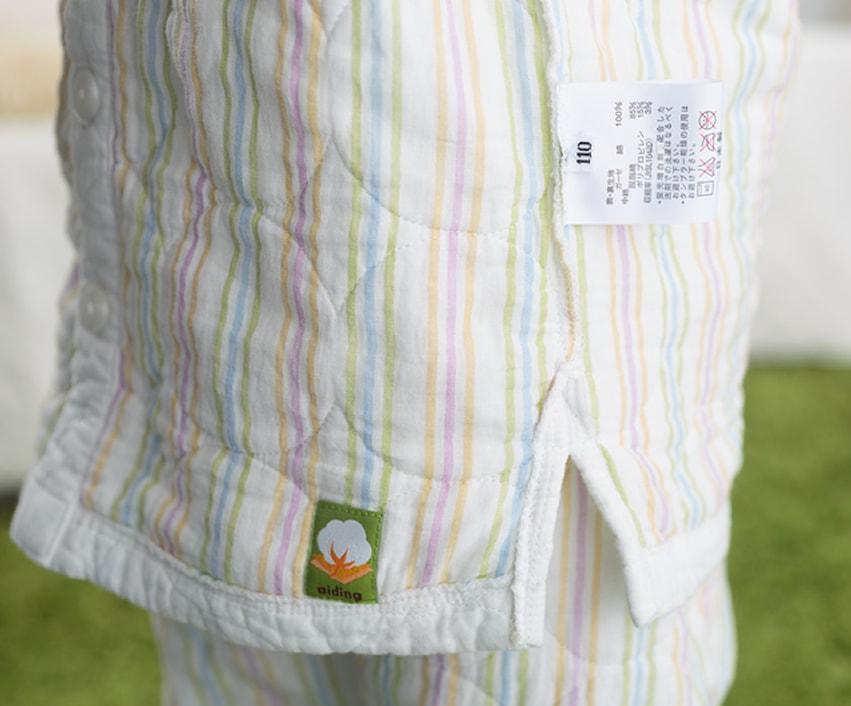 新作パシーマパジャマ ストライプ柄 品質表示 スリット アトピー肌や敏感肌の刺激にならないよう縫い代は表側に出して縫製しています。