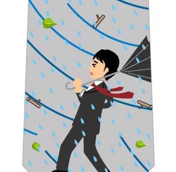 台風の中のビジネスマンネクタイの写真