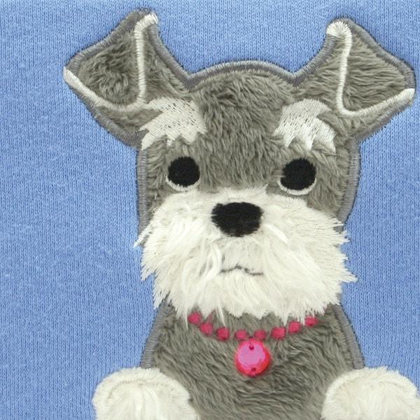 犬のシュナウザーがデザインされたポーチはDSやPSP、デジカメを入れるのに大人気。ゲームソフトやSDカードなどが入る内ポケットも魅力です。