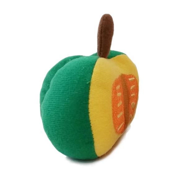 緑のかぼちゃのぬいぐるみペットトイ。半身で種も見えるデザインがキュート。キュッキュッと音がなるおもちゃに犬やネコなどペットも夢中。