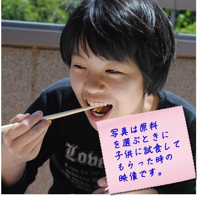 子供たちが秋刀魚味醂干しを試食した時の写真