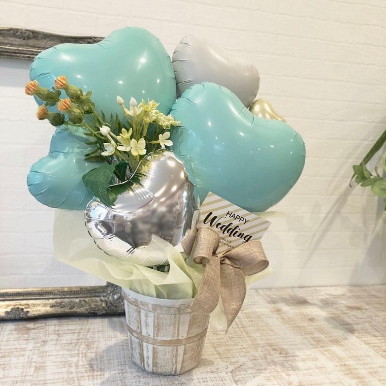 爽やかなミントカラーとお花でナチュラルでオシャレな雰囲気の置き型バルーンギフト 拡大1
