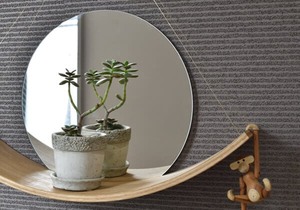 curved wod shelf with mirror