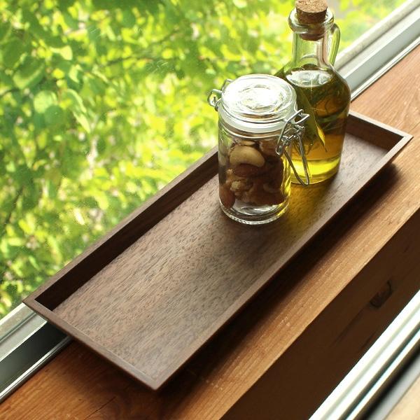 鏡板は反りや割れを防ぐために、表裏に突板加工を施しています。