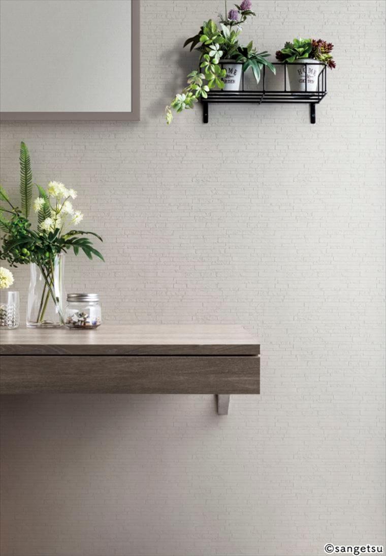 サンゲツSPクロス パターン タイル ブロックを貼ったライトグレーのモダンなタイル柄の部屋