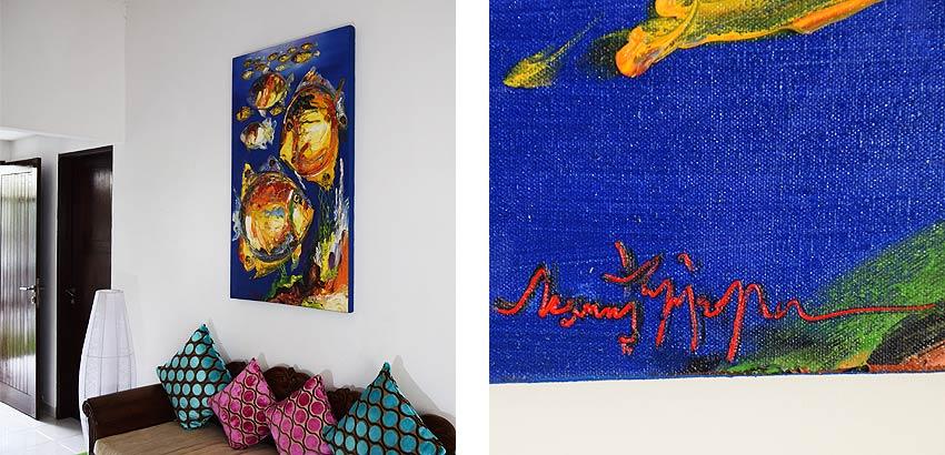 青い海を漂う魚の油絵