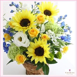 ひまわりと青い花