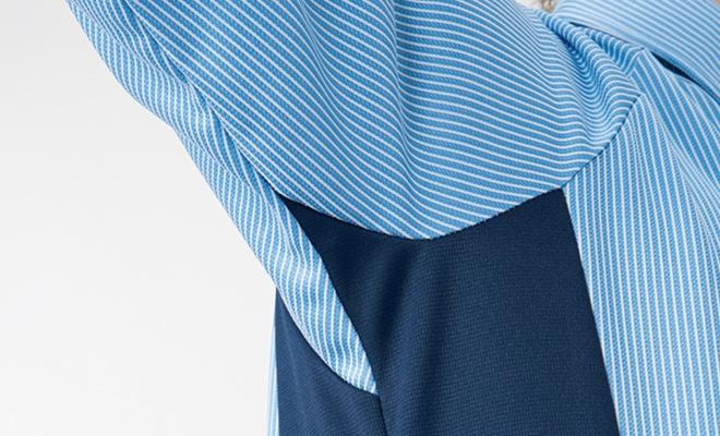 腕を上げても裾が持ち上がりにくく、腕がラクに動かせる特徴的なカッティングを施しています。