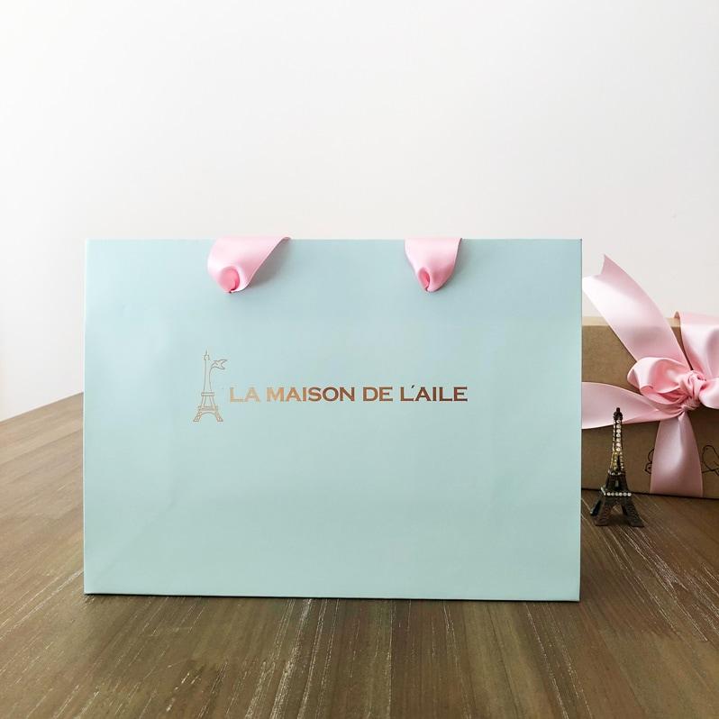 おしゃれなギフトバッグ通販。ピンクリボンの手提げ袋は入れるだけでかわいいラッピングに。