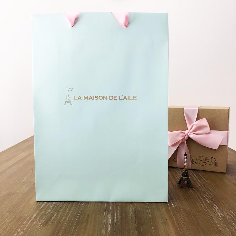 おしゃれなギフトバッグ通販。ピンクとリボンがかわいいラッピング袋です。入れるだけでおしゃれなプレゼントに。横浜山フランス雑貨ラメゾンドレイル